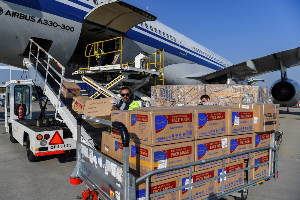 Loading stocks of PPE (face masks) in the cargo.